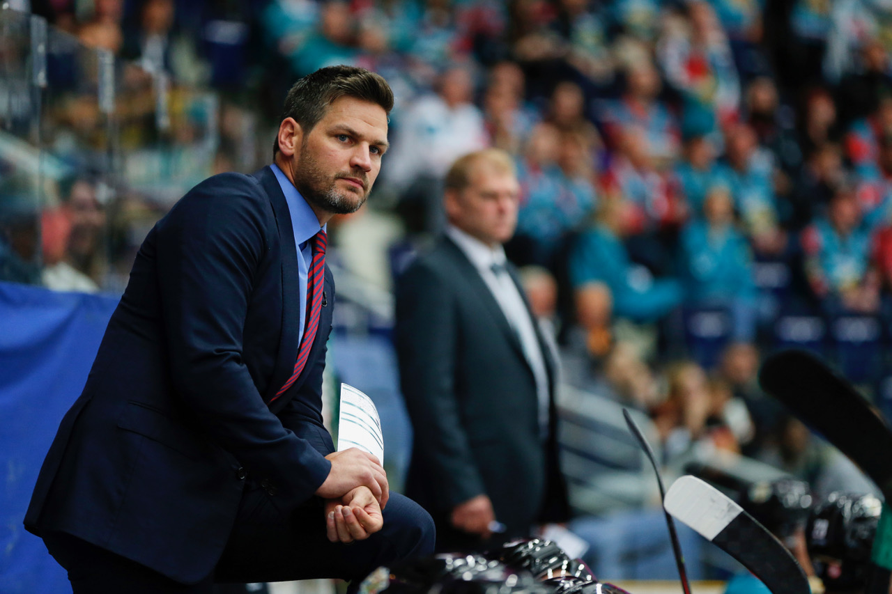 Adam Keefe of Giants watch his team.